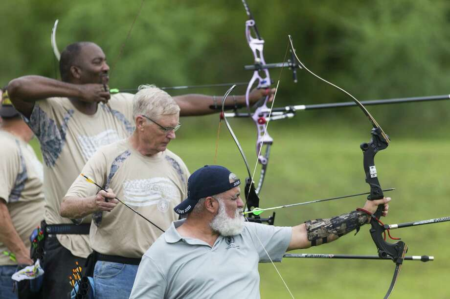 David Villarreal of Temple, from front, Don Puterbaugh of Springfield, Ohio, and Errol McKnight of St. Croix, Virgin Islands, compete Wednesday, Sept. 27, 2017 in the Valor Games 70 meter archery competition at Mission Concepci—n Sports Park. Photo: William Luther, Staff / San Antonio Express-News / © 2017 San Antonio Express-News