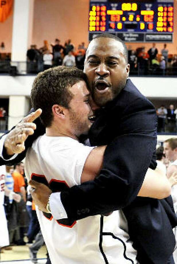 Tony Newsom, right, was named coach of the basketball program at St. Luke's. Photo: Contributed Photo / New Canaan News contributed