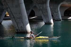 Charlie Maguire of Foster city cruises under the Beach Park overpass in his kayak on Wed. Sept. 27, 2017., in Foster City, Ca, as warm temperatures cover the Bay Area with cooling expected to begin tomorrow.