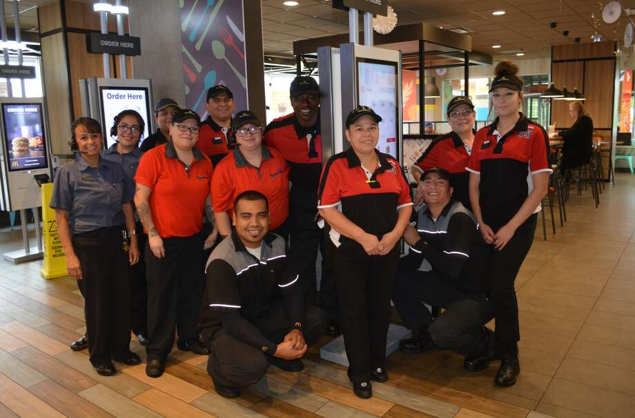 Some of the morning crew at Plainview's McDonald's Restaurant gather Wednesday around a self-order kiosk, one of three installed in late August. In less than 30 days, the kiosks are proving popular with customers by accounting for almost 40 percent of in-store orders. Among the added conveniences of the kiosks is that customer orders are delivered to their table instead of having the customer wait at the counter. Isabel Diaz (center front) will be representing the local McDonald's Oct. 21 in Dallas for the lobby portion of the regional All-American Competition. Angelica Senta will be competing in the drive-thru runner category.