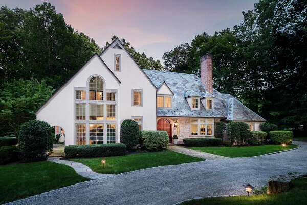 The white-washed brick and stucco colonial with gray trim at 1533 Fence Row Drive has 12 rooms and 5,136 square feet of living space.