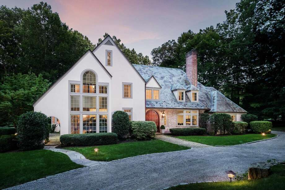 The white-washed brick and stucco colonial with gray trim at 1533 Fence Row Drive has 12 rooms and 5,136 square feet of living space. Photo: Nathan Spotts And /or Lauren Kinkade / / © Nathan Spotts & Lauren Kinkade