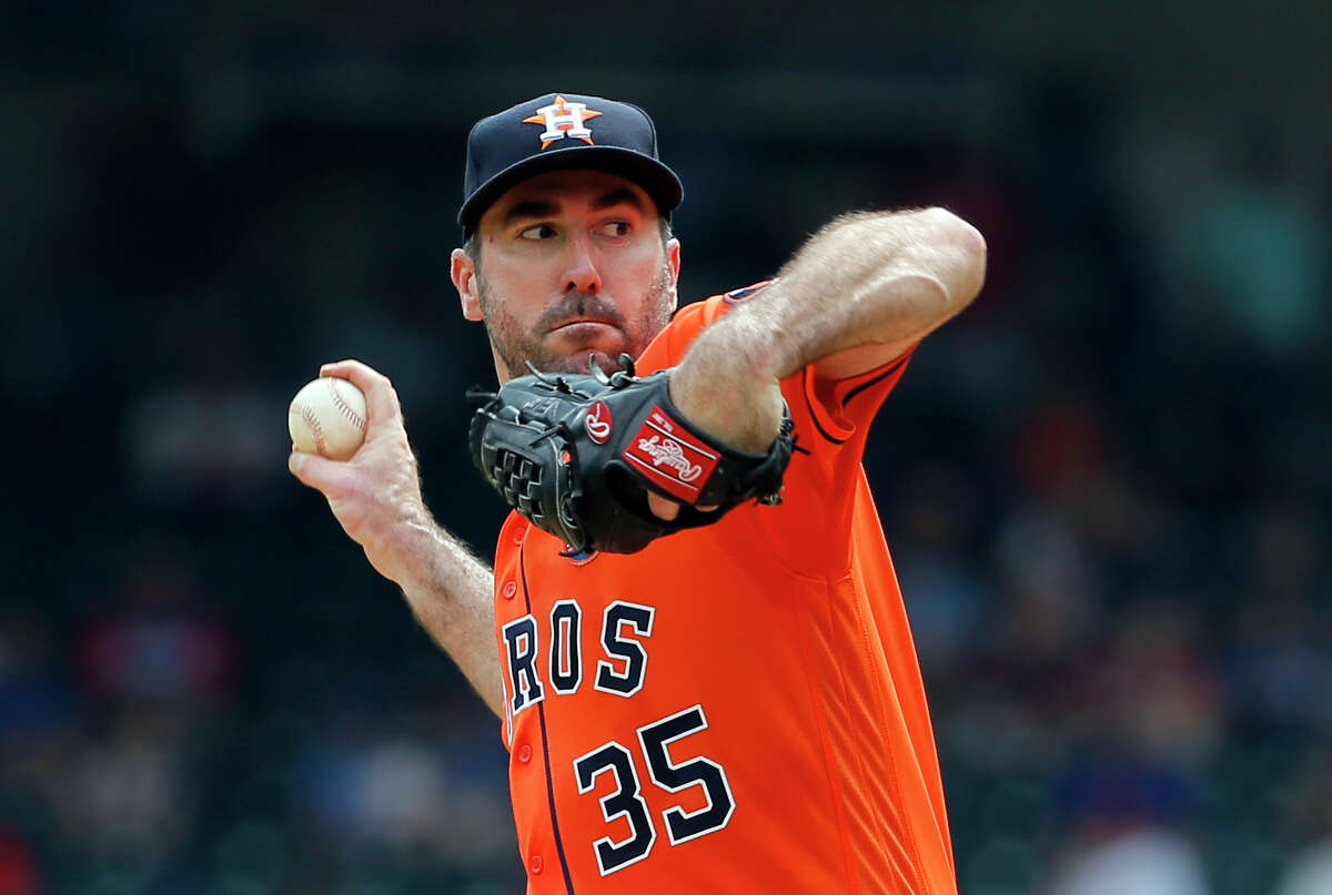 Houston Astros starting pitcher Justin Verlander (35) winds up to throw to the Texas Rangers in the fourth inning of a baseball game, Wednesday, Sept. 27, 2017, in Arlington, Texas. (AP Photo/Tony Gutierrez)