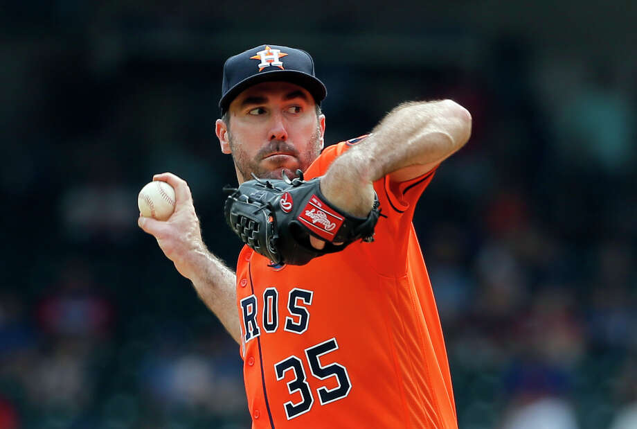 Houston Astros starting pitcher Justin Verlander (35) winds up to throw to the Texas Rangers in the fourth inning of a baseball game, Wednesday, Sept. 27, 2017, in Arlington, Texas. (AP Photo/Tony Gutierrez) Photo: Tony Gutierrez, Associated Press / Copyright 2017 The Associated Press. All rights reserved.