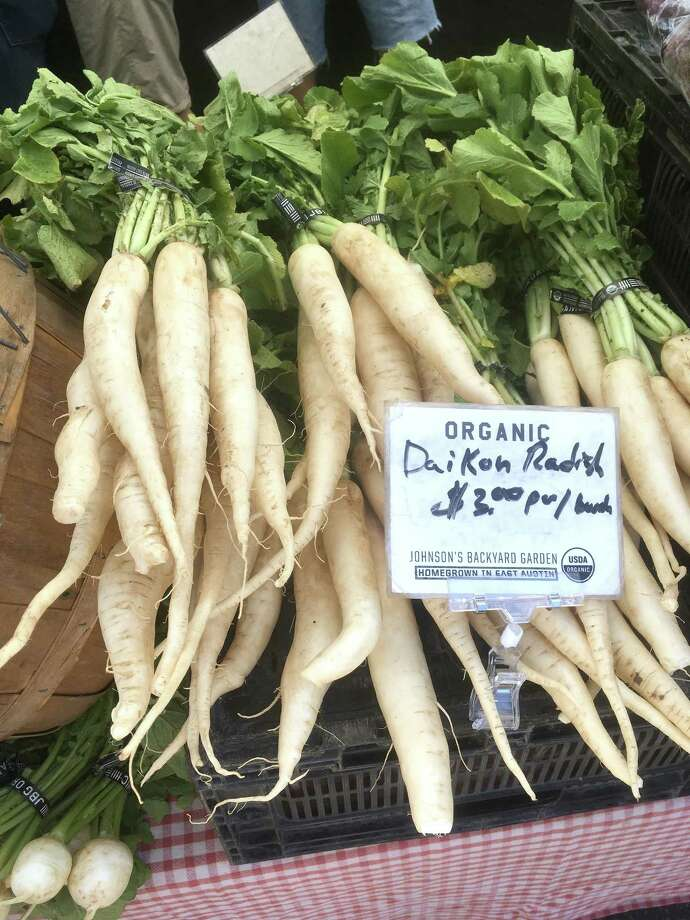 Daikon radishes are currently offered at the New Braunfels Farmers Market. They are a mild-flavored winter radish. Photo: Chuck Blount / San Antonio Express-News