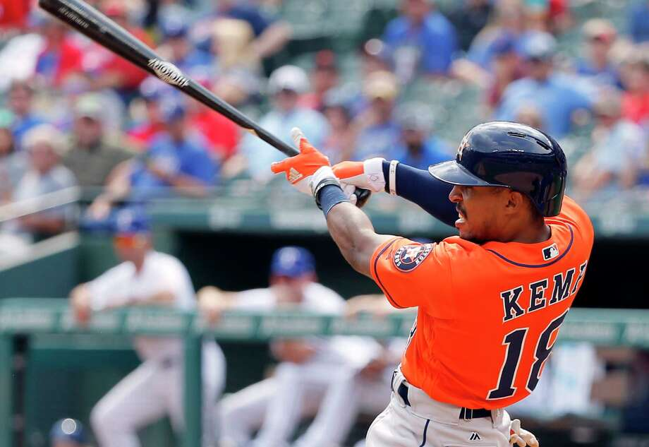 Houston Astros' Tony Kemp (18) follows through on a run-scoring single off a pitch from Texas Rangers' Nick Martinez in the fourth inning of a baseball game, Wednesday, Sept. 27, 2017, in Arlington, Texas. The hit scored Brian McCann. (AP Photo/Tony Gutierrez) Photo: Tony Gutierrez, Associated Press / Copyright 2017 The Associated Press. All rights reserved.
