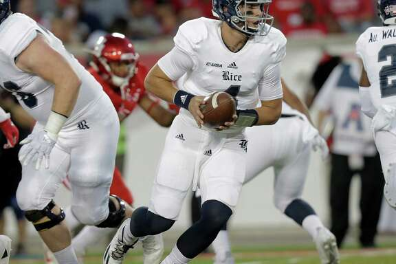 Rice Owls quarterback Sam Glaesmann (4) looks to  handoff the ball in the first inning agianst Houston Cougars at TDECU Stadium on Saturday, Sept. 16, 2017, in Houston. ( Elizabeth Conley / Houston Chronicle )