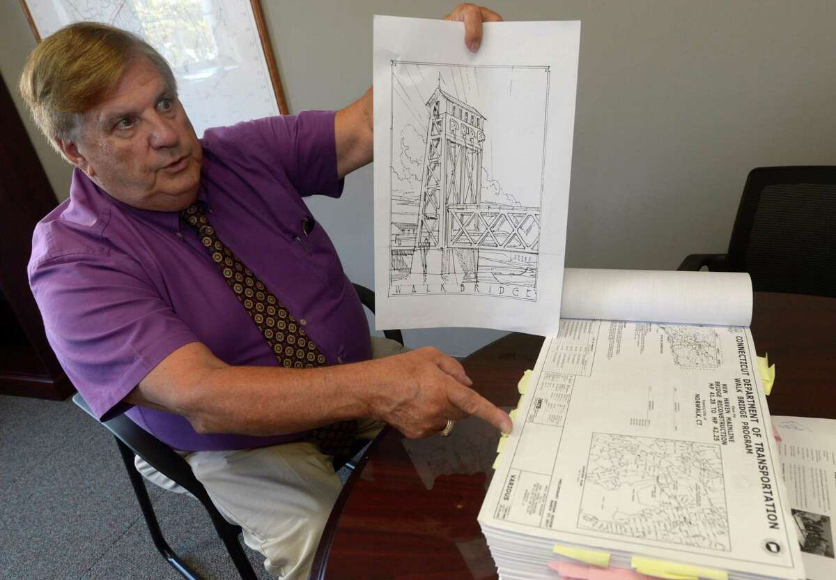 Norwalk Department of Public Works Director Bruce Chimento displays drawings of what the new Walk Bridge might look like Tuesday, Sept. 26, in his office at City Hall in Norwalk. A local ad-hoc panel comprising city officials, business leaders and a local architect have been meeting with the Connecticut Department of Transportation in an effort to spruce up the appearance of the 240-foot, vertical-lift span bridge, which the DOT plans to replace.