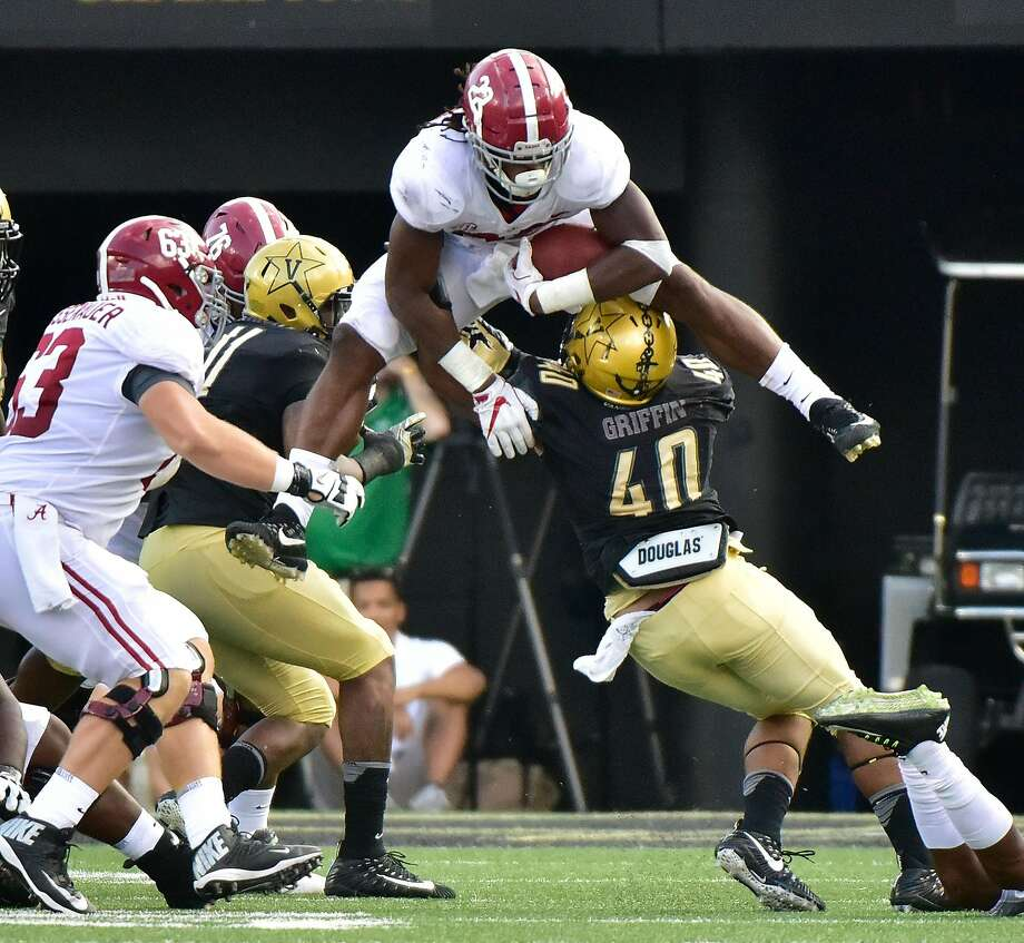 NASHVILLE, TN - SEPTEMBER 23:  Najee Harris #22 of the Alabama Crimson Tide jumps over Jordan Griffin #40 of the Vanderbilt Commodores during the second half at Vanderbilt Stadium on September 23, 2017 in Nashville, Tennessee.  (Photo by Frederick Breedon/Getty Images) Photo: Frederick Breedon, Getty Images