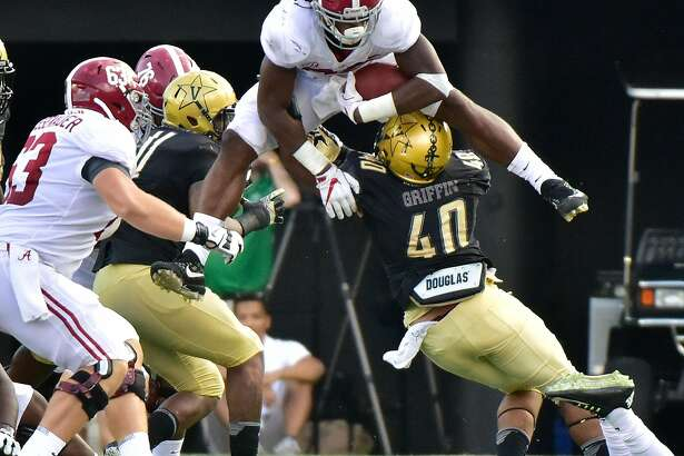NASHVILLE, TN - SEPTEMBER 23:  Najee Harris #22 of the Alabama Crimson Tide jumps over Jordan Griffin #40 of the Vanderbilt Commodores during the second half at Vanderbilt Stadium on September 23, 2017 in Nashville, Tennessee.  (Photo by Frederick Breedon/Getty Images)