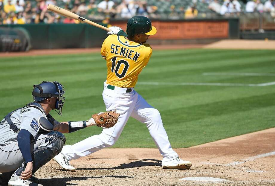 OAKLAND, CA - SEPTEMBER 27:  Marcus Semien #10 of the Oakland Athletics hits a sacrifice fly scoring Franklin Barreto #1 against the Seattle Mariners in the bottom of the third inning at Oakland Alameda Coliseum on September 27, 2017 in Oakland, California.  (Photo by Thearon W. Henderson/Getty Images) Photo: Thearon W. Henderson, Getty Images