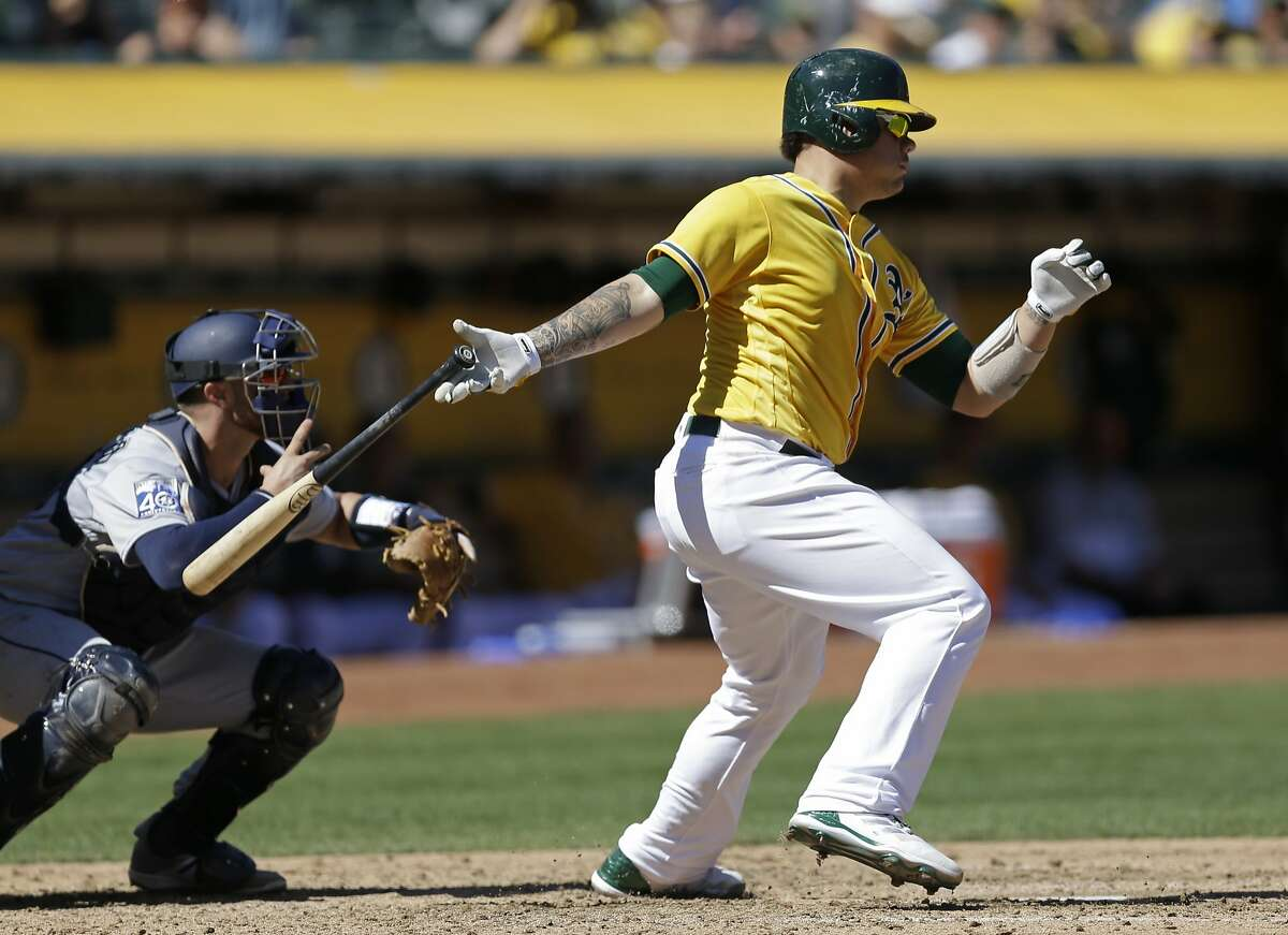 Oakland Athletics' Bruce Maxwell drops his bat after hitting an RBI single off Seattle Mariners' Erasmo Ramirez in the fourth inning of a baseball game Wednesday, Sept. 27, 2017, in Oakland, Calif. (AP Photo/Ben Margot)