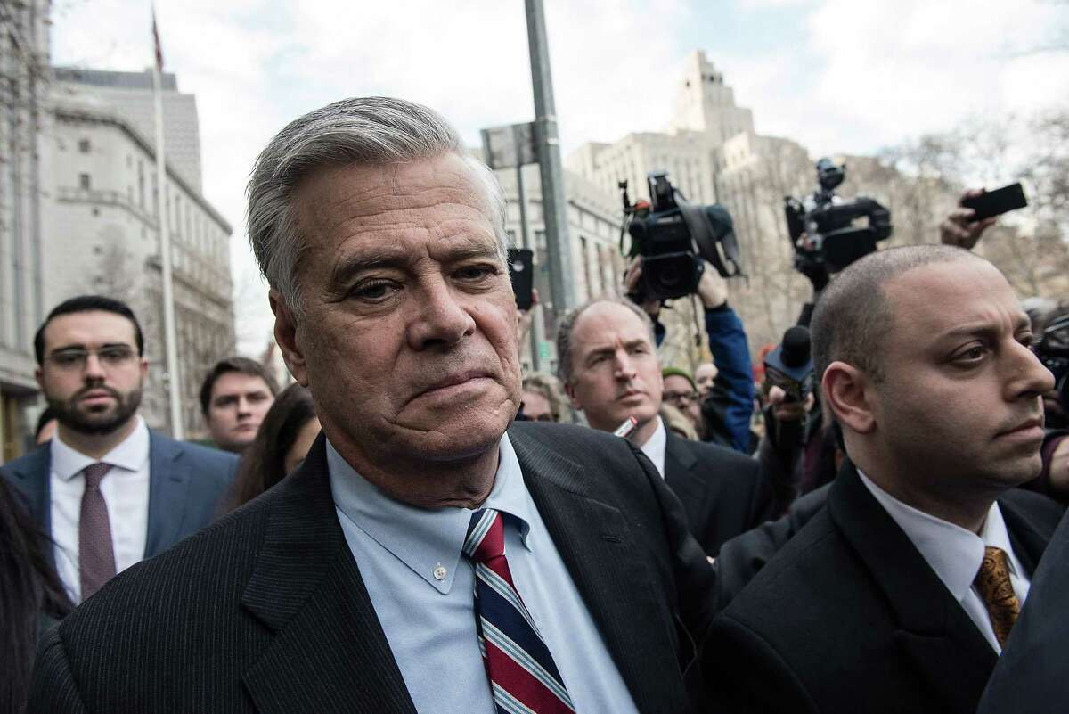 FILE N Dean Skelos, the former majority leader of the New York State Senate, leaves a Manhattan courthouse after being found guilty of bribery, extortion and conspiracy, Dec. 11, 2015. A federal appeals panel cited a recent Supreme Court decision narrowing the legal definition of corruption in overturning the conviction of Skelos and his son, Adam Skelos, on Sept. 26, 2017. (Andrew Renneisen/The New York Times) ORG XMIT: XNYT141