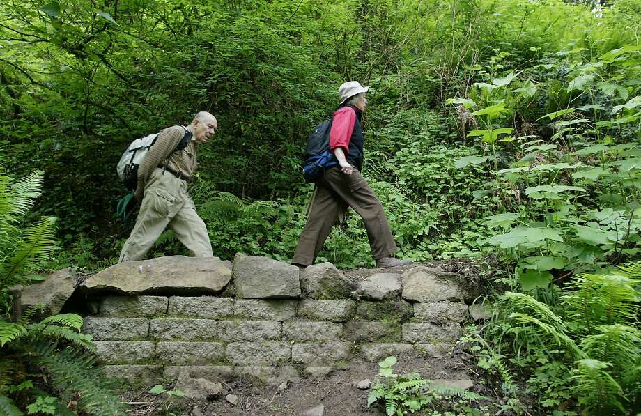 5/15/04- Paul, 82, and Maria, 79, Fellner, of NW Portland, hike in Forest Park. Portland's largest city park, every week. Photo: MERYL SCHENKER