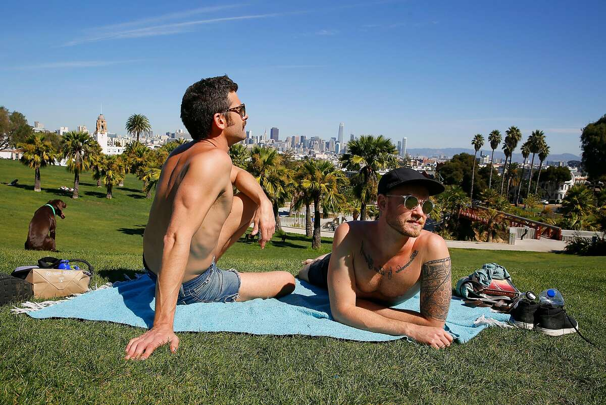 Jay Lisk and Michael Farr visitting on a road trip from Columbus, Ohio enjoy the noon hour at Dolores Park on Tuesday, September 26, 2017, in San Francisco, Calif.