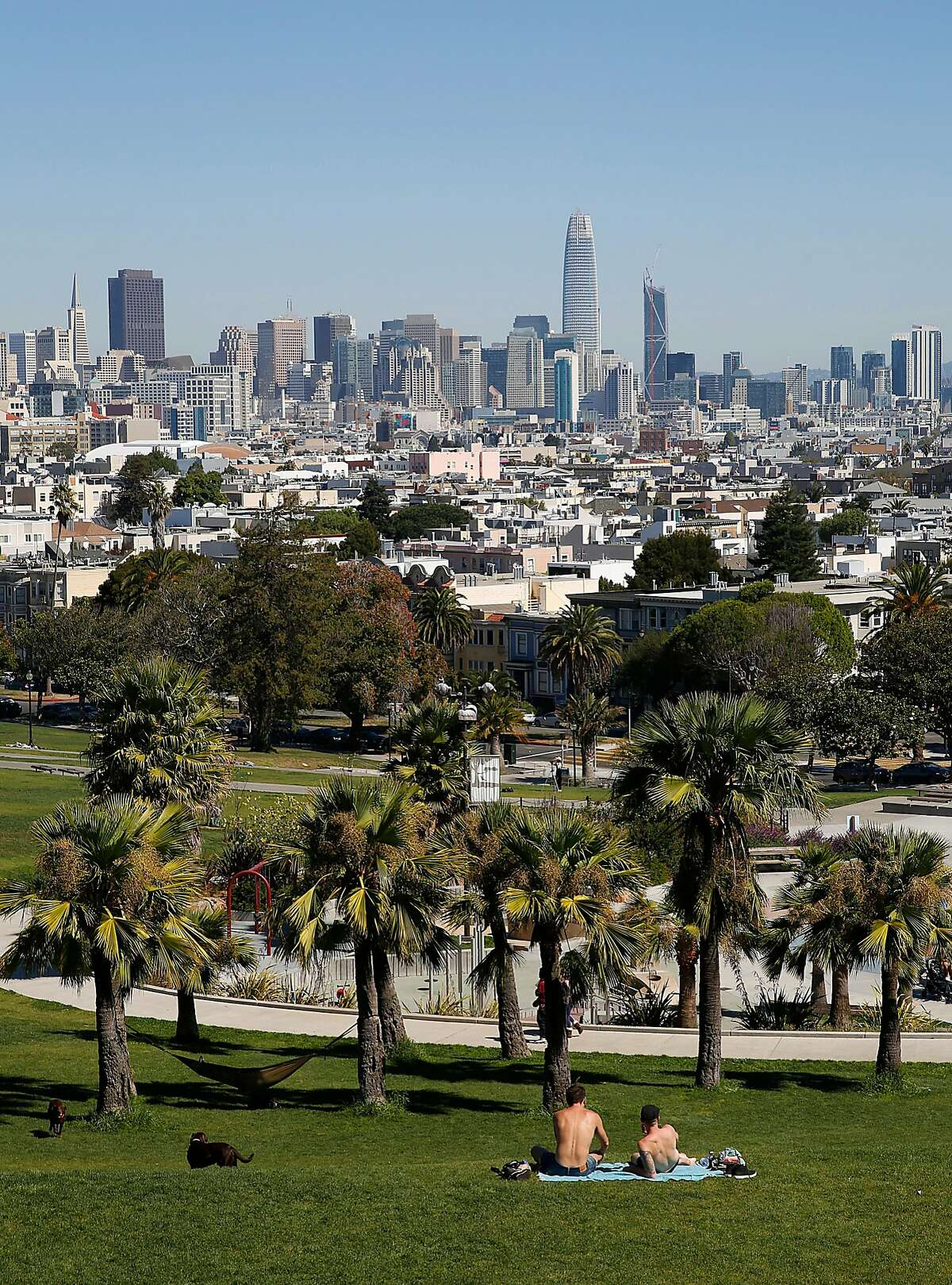 Jay Lisk and Michael Farr visiting on a road trip from Columbus, Ohio enjoy the noon hour at Dolores Park on Tuesday, September 26, 2017, in San Francisco, Calif.