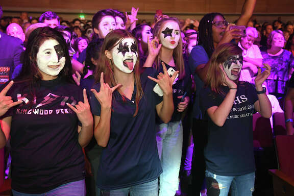 """Kingwood High School students join KISS during their performance of """"Rock and Roll All Night"""" during their fundraising campaign at Smart Financial Centre in Sugar land on Sept. 26, 2017. (Photo by Jerry Baker/Freelance)"""