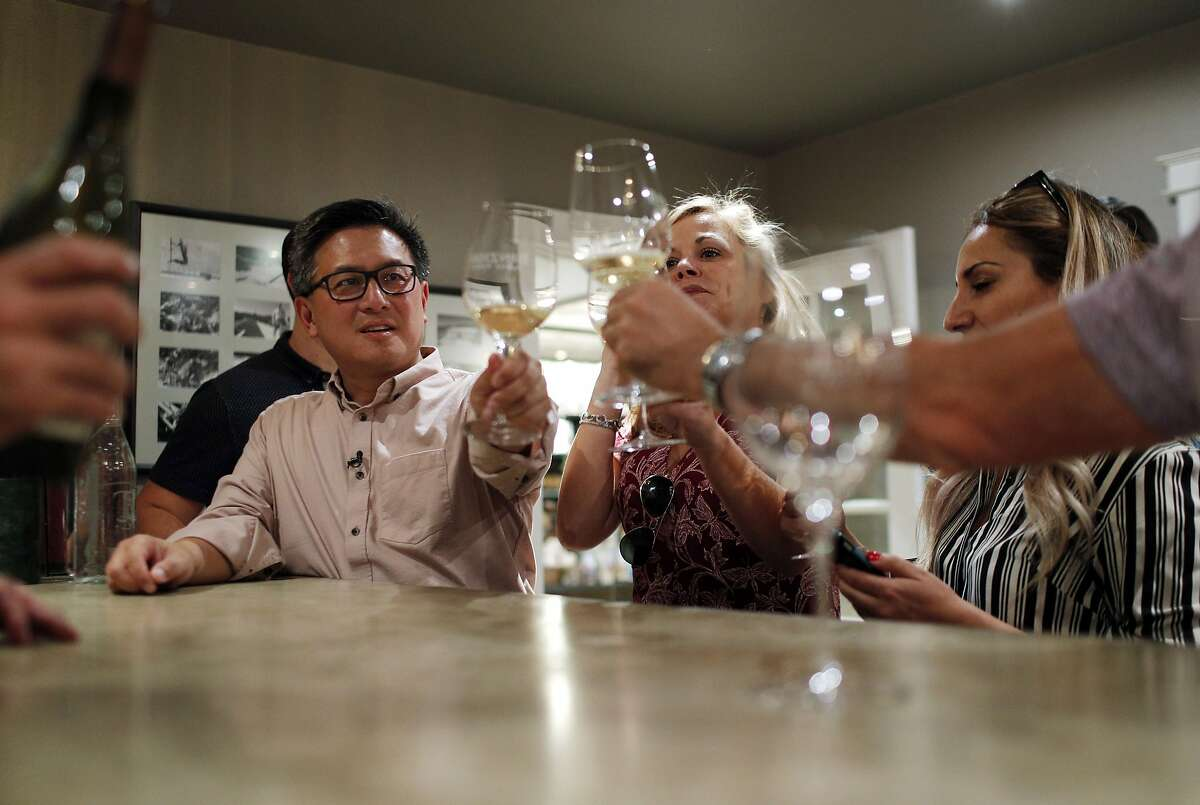 John Chiang samples some wine with his campaign staff served by Mark Burningham, left, as they take a tour of the Benziger Family Winery for his campaign for governor in Glen Ellen, Calif., on Tuesday, September 26, 2017.