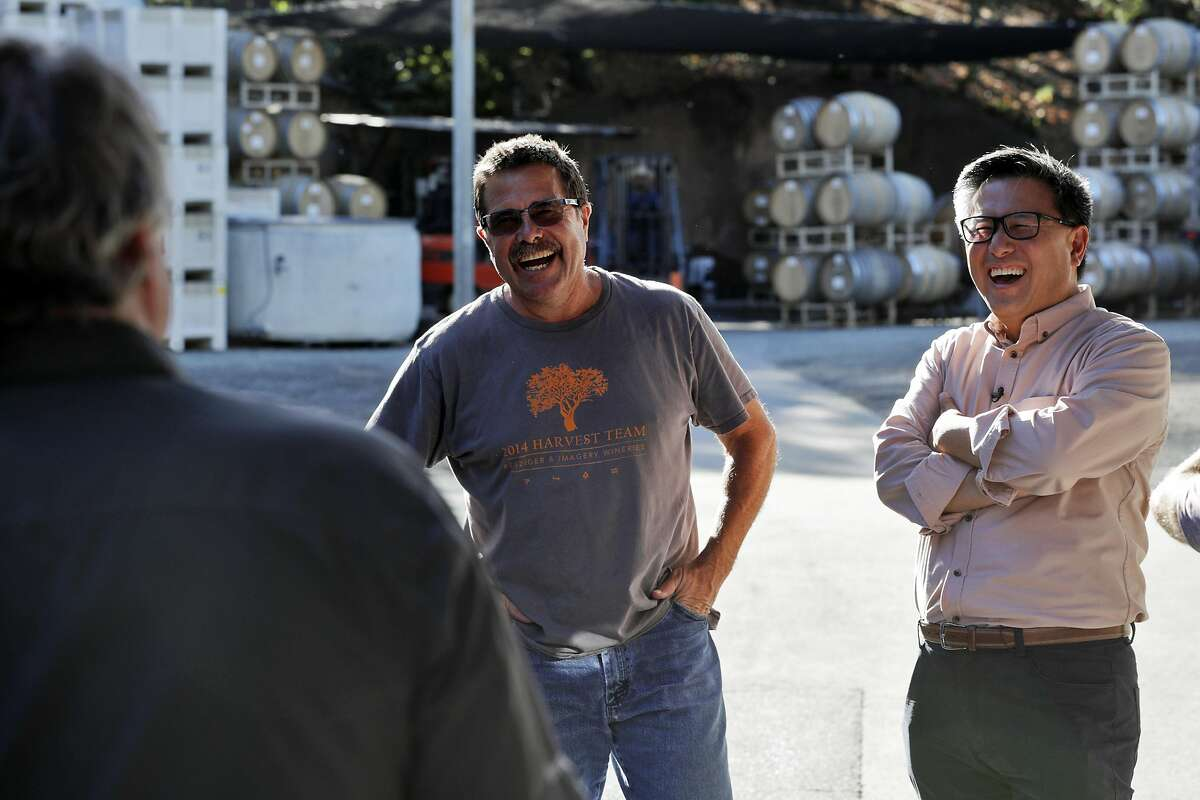 John Chiang, right, laughs as he takes a tour of the Benziger Family Winery with Joe Benziger, center, and Mark Burningham, left, for his campaign for governor in Glen Ellen, Calif., on Tuesday, September 26, 2017.