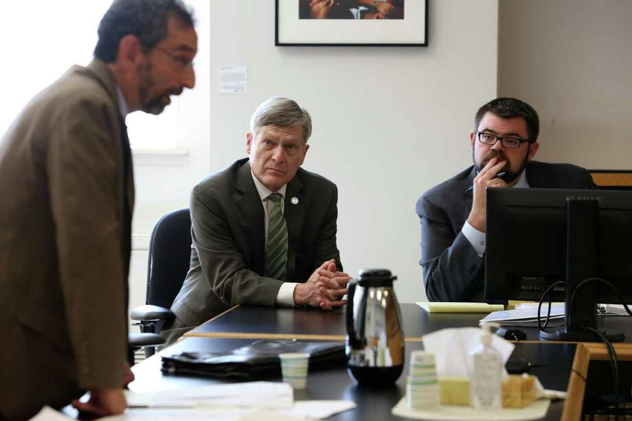 Seattle city attorney Pete Holmes, center, listens as defense attorney for Kareem Jalil Robert Goldsmith makes his arguments in court in the case of Seattle v. Jalil, Sept. 27, 2018. Judge Sean O'Donnell ruled in the city's favor on Monday, allowing city prosecutors to continue their new policy of offering a 12-month deferred jail sentence on the condition a first-time defendant enters a guilty plea. Photo: GENNA MARTIN, SEATTLEPI / SEATTLEPI.COM