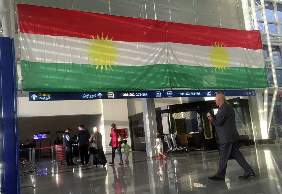 A Kurdish flag hangs in the Irbil International Airport in Iraq on Wednesday. Responding to an independence vote, Iraq's prime minister ordered the country's Kurdish region to hand over control of its airports to federal authorities. Photo: Khalid Mohammed, STF / Copyright 2017 The Associated Press. All rights reserved.