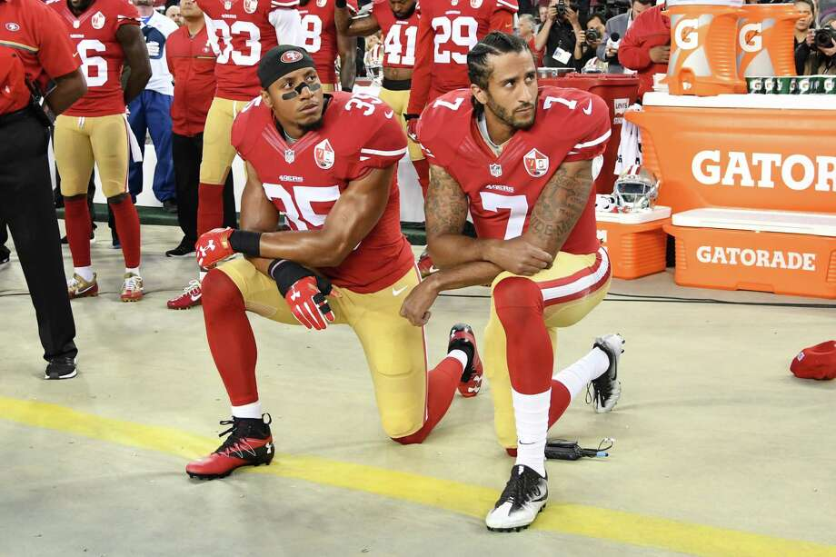 Eric Reid, left, and Colin Kaepernick kneel in protest during the national anthem on September 12, 2016. Photo: Thearon W. Henderson, Stringer / 2016 Getty Images