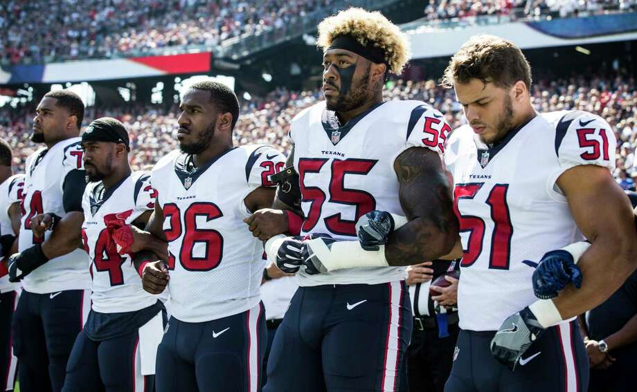 Houston Texans players lock arms during the national anthem before the Texans NFL football game against the New England Patriots at Gillette Stadium on Sunday, Sept. 24, 2017, in Foxbourough, Mass. ( Brett Coomer / Houston Chronicle ) Photo: Brett Coomer, Staff / © 2017 Houston Chronicle