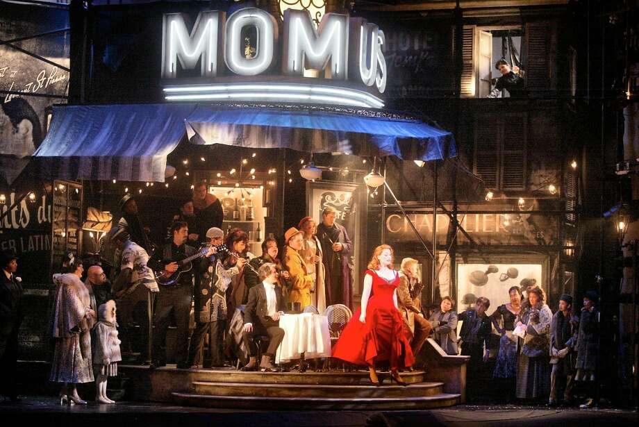 BOHEME17d-C-04OCT02-DD-MK ---the red cast of Baz Luhrmann's La Boheme in the Momus scene. BY MIKE KEPKA/THE CHRONICLE Photo: MIKE KEPKA, SFC