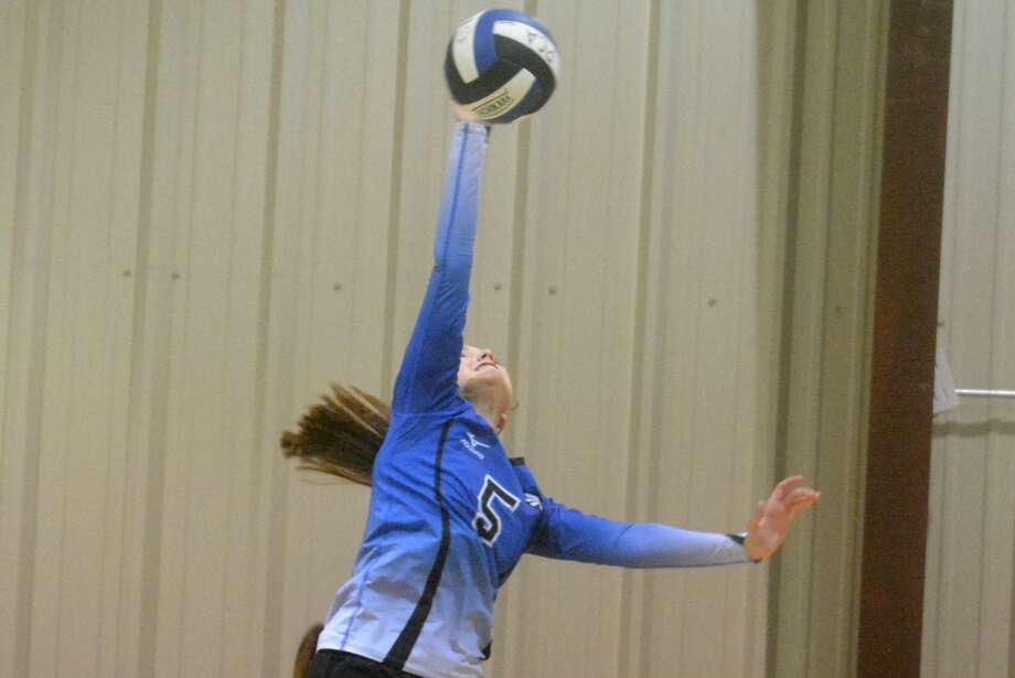 Plainview Christian Academy's Stephanie Stukey hits the ball during a volleyball match earlier this season. The Lady Eagles defeated Idalou Tuesday and will open district play Friday at Southcrest. Photo: Skip Leon/Plainview Herald