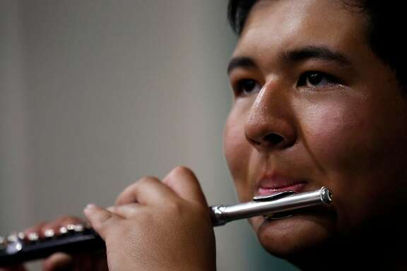 Piccolo player Matt Origel, 15, practices with some of his fellow band members during a 12-hour marching band rehearsal at Homestead High School July 15, 2017 in Cupertino, Calif.