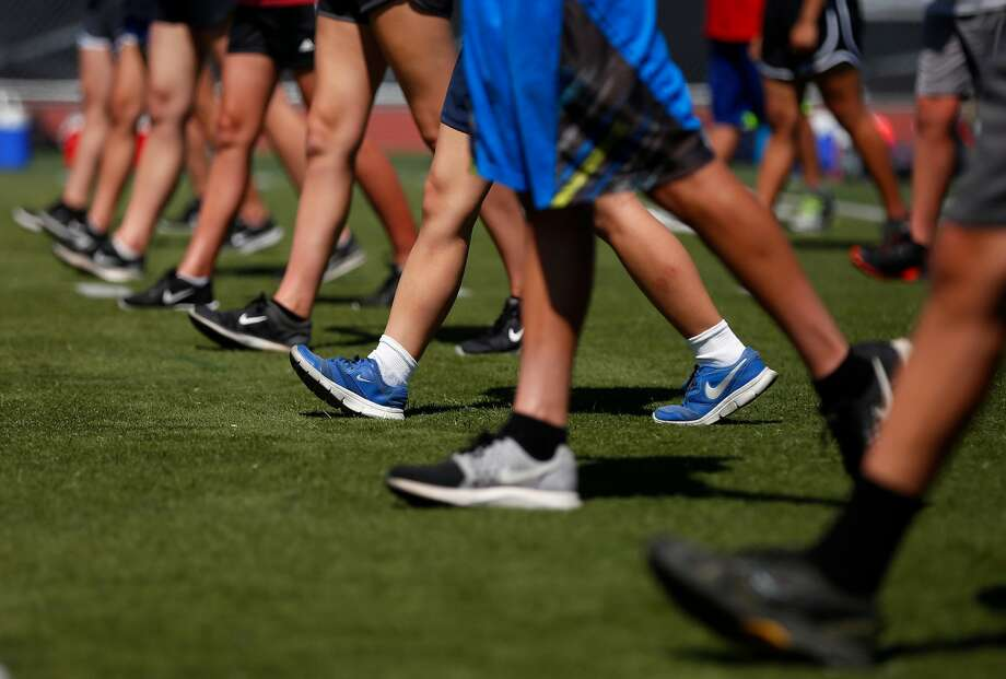 Marching band members practice their footwork. Photo: Leah Millis, The Chronicle