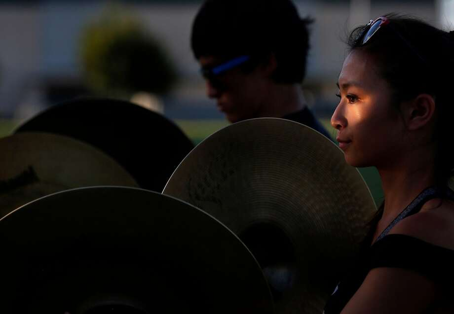 Mitchi Phung, 16, plays cymbals during band rehearsal. Photo: Leah Millis, The Chronicle