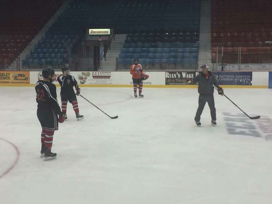 New RPI coach Dave Smith explains the penalty kill during practice at Houston Field House in Troy on Sept. 27, 2017. (Leif Skodnick / Times Union)