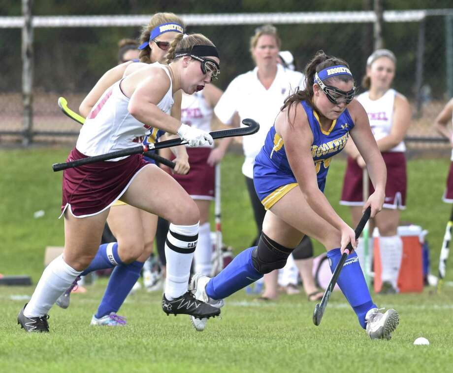 Brookfield's Sydney Donnelly (20) races ahead of Bethel's  Christina Franzese (20) in the girls field hockey game between Brookfield and Bethel high schools, on Wednesday afternoon, September 27, 2017, at Bethel High School, in Bethel, Conn. Photo: H John Voorhees III / Hearst Connecticut Media / The News-Times