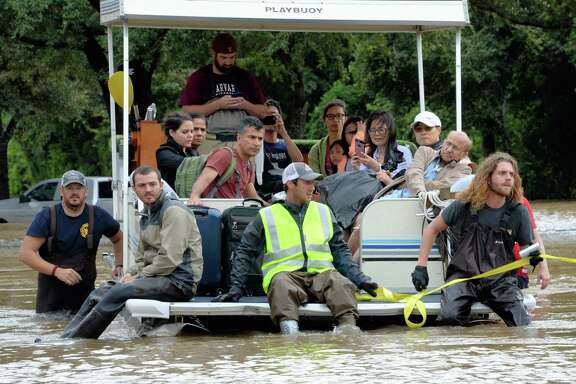 Residents of the Cinco Ranch and Canyon Gate subdivisions  evacuate from their homes that are near the west side of the Barker Reservoir in Fort Bend County on Aug. 29.
