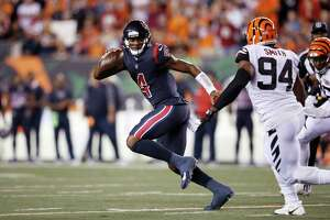 CINCINNATI, OH - SEPTEMBER 14: Deshaun Watson #4 of the Houston Texans runs away from Chris Smith #94 of the Cincinnati Bengals while trying to pass during a game at Paul Brown Stadium on September 14, 2017 in Cincinnati, Ohio. The Texans won 13-9. (Photo by Joe Robbins/Getty Images)