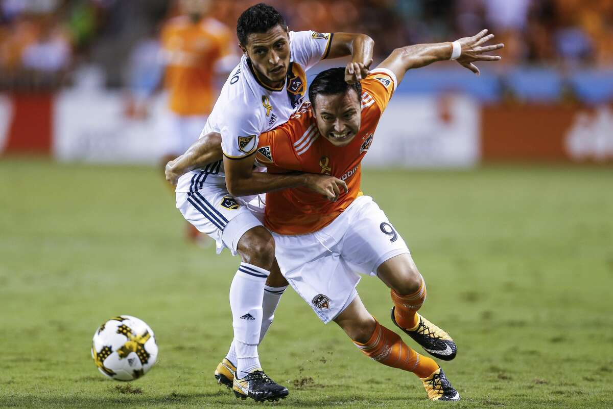 Houston Dynamo forward Erick Torres (9) tries to get past Los Angeles Galaxy defender Hugo Arellano (21) as the Houston Dynamo take on the Los Angeles Galaxy at BBVA Compass Stadium Wednesday, Sept. 27, 2017 in Houston. ( Michael Ciaglo / Houston Chronicle)