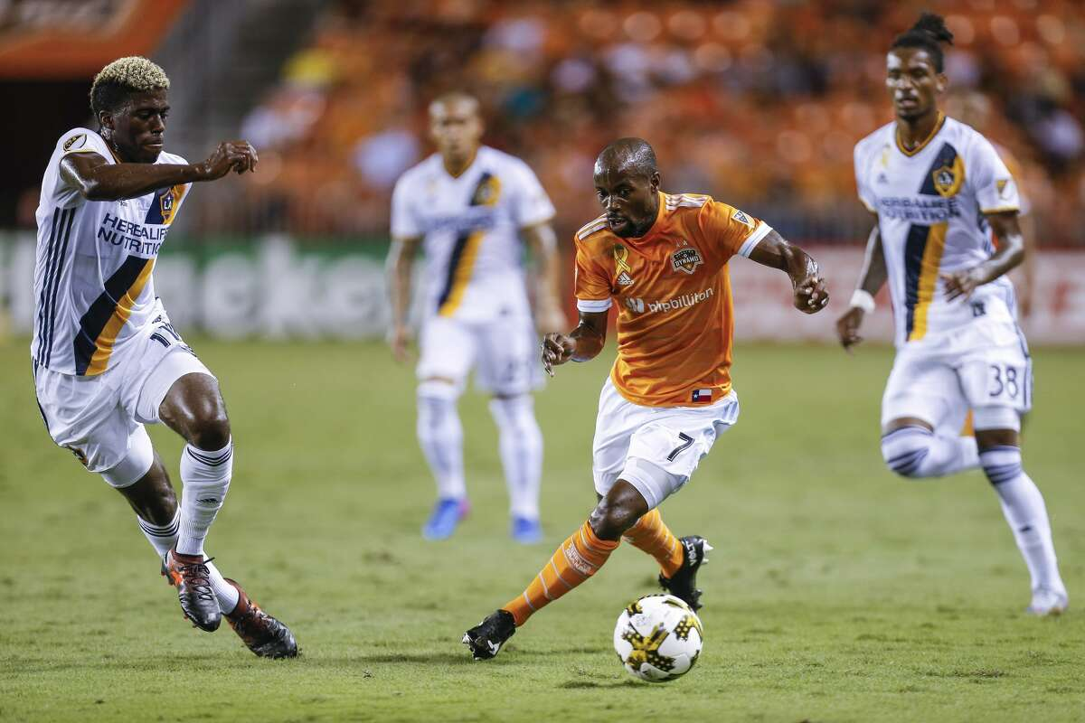 Houston Dynamo midfielder DaMarcus Beasley (7) drives down the field past Los Angeles Galaxy forward Gyasi Zerdes (11) as the Houston Dynamo take on the Los Angeles Galaxy at BBVA Compass Stadium Wednesday, Sept. 27, 2017 in Houston. ( Michael Ciaglo / Houston Chronicle)