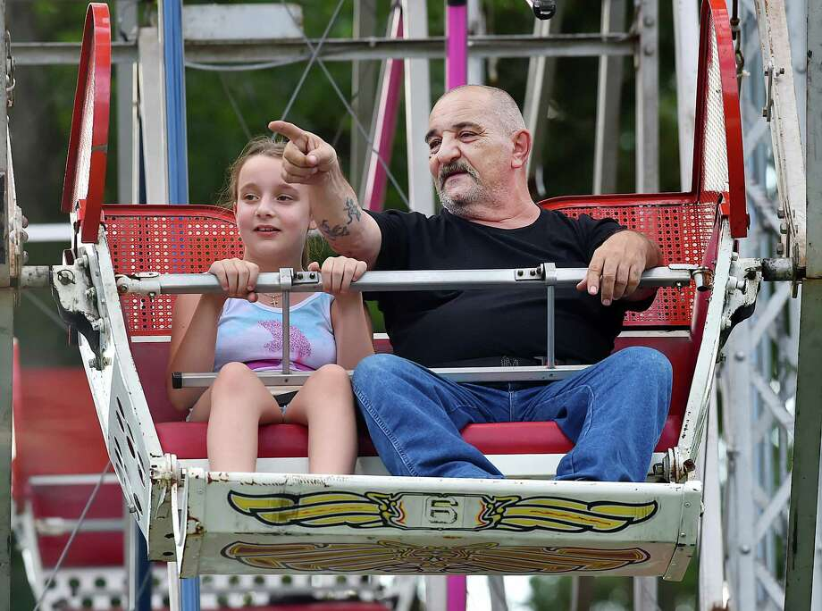 Derby resident John Dicapua and his 10-year-old granddaughter Talia Dicapua get a birdseye-look from the ferris wheel at the annual Citizens Engine Co. #2 carnival, Saturday, July 15, 2017, at French Memorial Park at 62 Spruce St. in Seymour.  (Catherine Avalone – Hearst Connecticut Media) Photo: Catherine Avalone, Catherine Avalone/New Haven Register / Catherine Avalone/New Haven Register