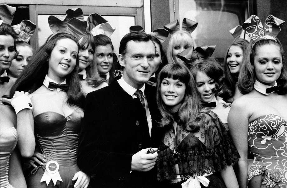 Hugh Hefner, publisher and owner of Playboy magazine, and his girlfriend Barbara Benton, 19-year-old coed turned actress, are surrounded by Bunny Girls at the Playboy Club in London, on Sept. 5, 1969. Photo: AP