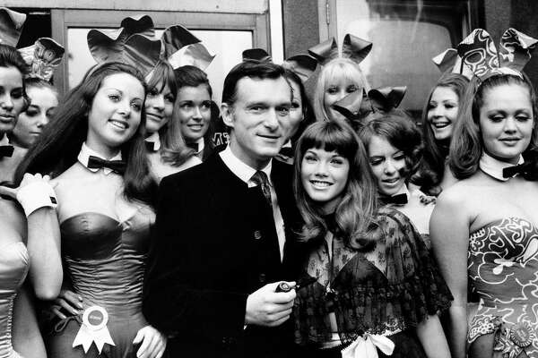 Hugh Hefner, publisher and owner of Playboy Magazine, and his girlfriend Barbara Benton, 19-year-old coed turned actress, are surrounded by Bunny Girls at the Playboy Club in London, on September 5, 1969. (AP Photo)