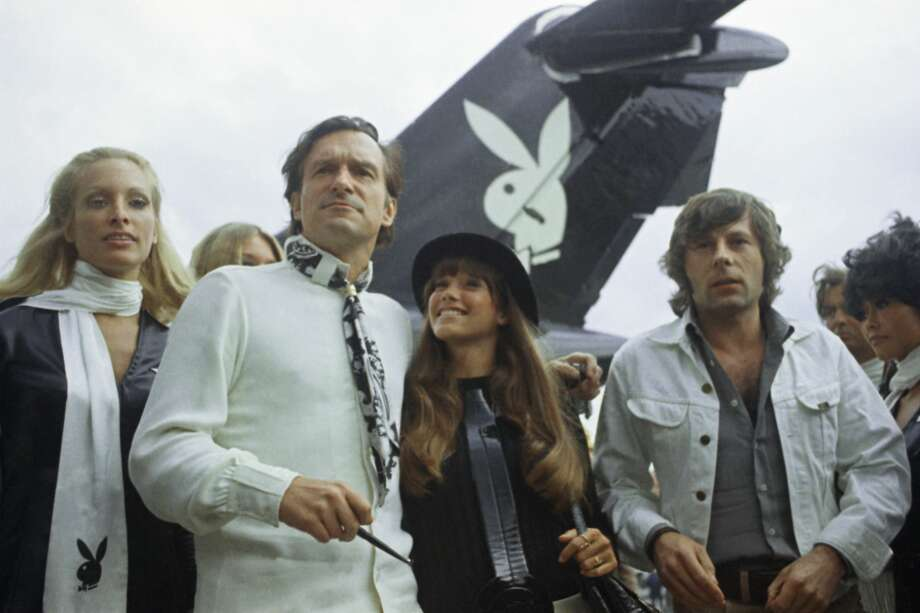 Playboy publisher Hugh Hefner, second from left, arrives with his girlfriend Barbi Benton, center, and film director Roman Polanski, right, Aug. 21, 1970, Paris, France. The woman at left is unidentified. Photo: Michel Lipchitz/AP