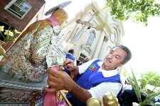 A procession follows the statue of Santa Maria Maddalena, the patron saint of Atrani, Italy, through the Wooster Square neighborhood from St. Michael's Church to the Santa Maria Maddalena Society in New Haven on 7/23/2017.  Arnold Gold / Hearst Connecticut Media