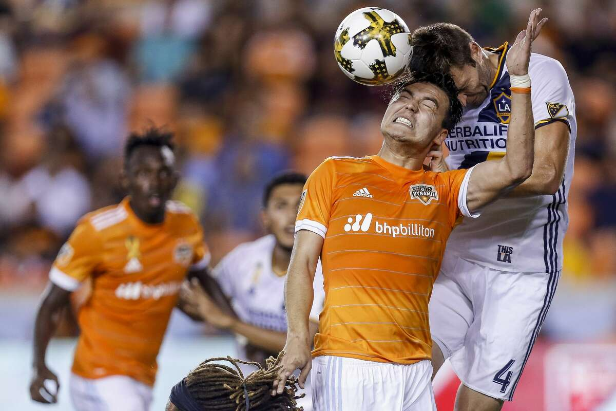 Houston Dynamo forward Erick Torres (9) and Los Angeles Galaxy defender Dave Romney (4) head a ball as the Houston Dynamo tie the Los Angeles Galaxy 3-3 at BBVA Compass Stadium Wednesday, Sept. 27, 2017 in Houston. ( Michael Ciaglo / Houston Chronicle)