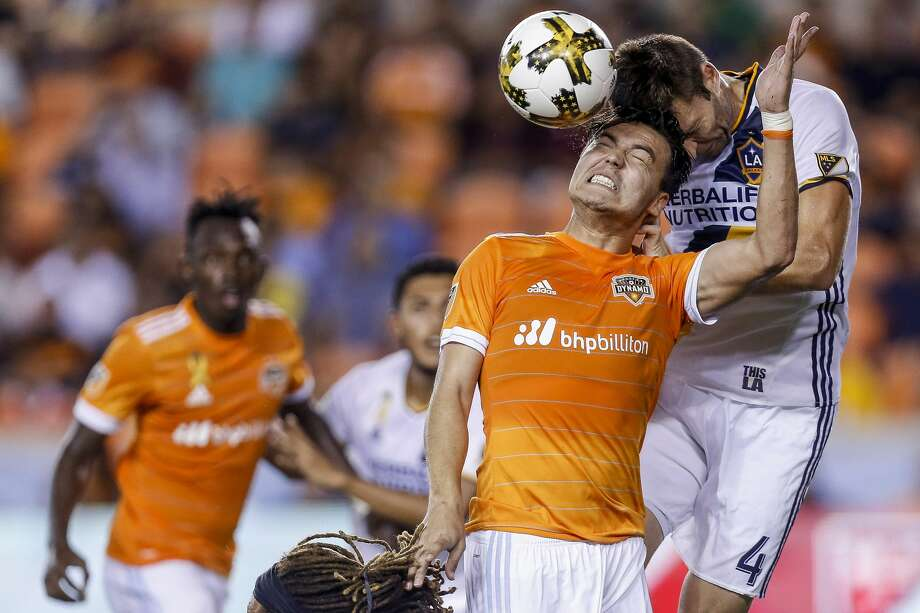 Houston Dynamo forward Erick Torres (9) and Los Angeles Galaxy defender Dave Romney (4) head a ball as the Houston Dynamo tie the Los Angeles Galaxy 3-3 at BBVA Compass Stadium Wednesday, Sept. 27, 2017 in Houston. ( Michael Ciaglo / Houston Chronicle) Photo: Michael Ciaglo/Houston Chronicle