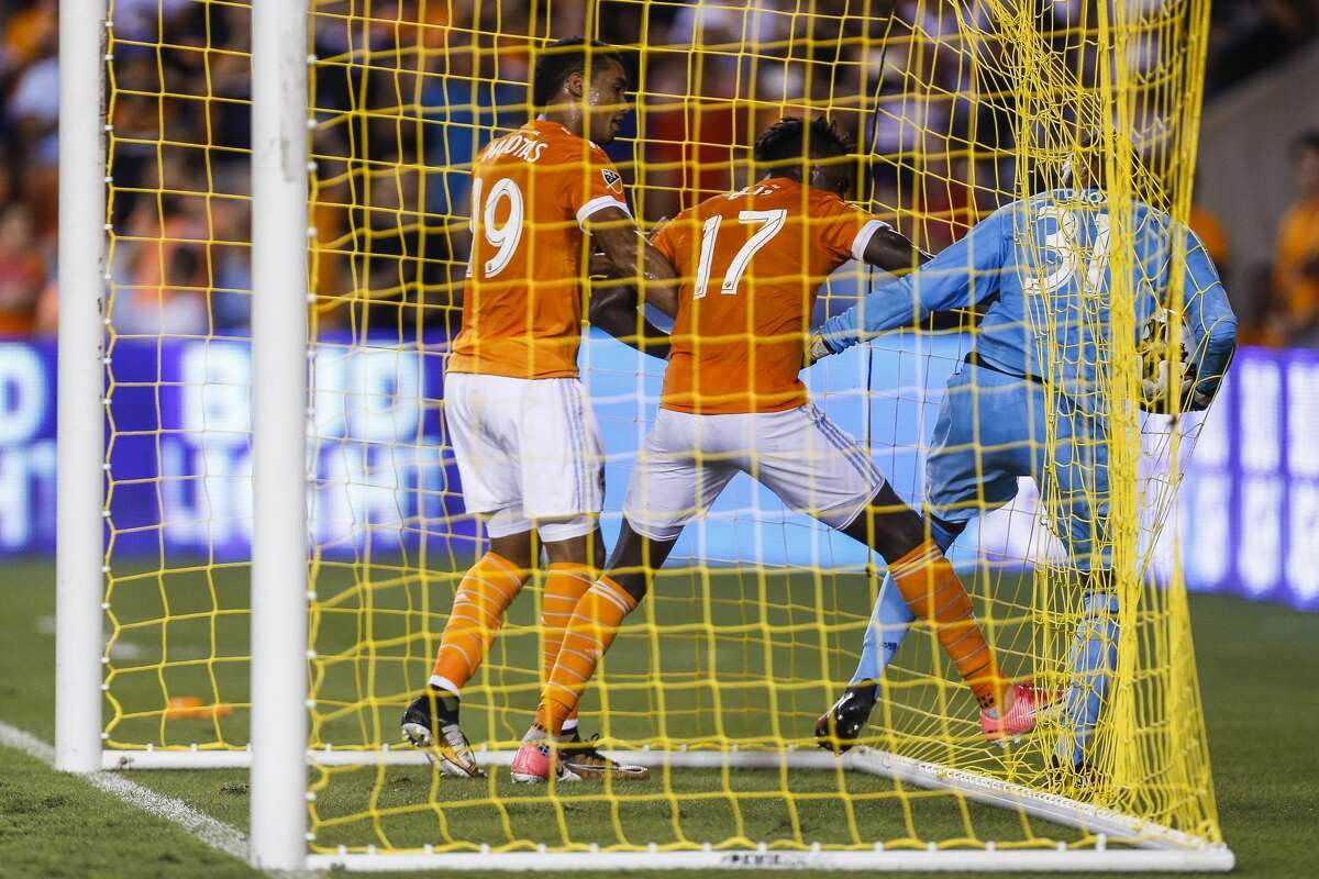 Houston Dynamo forward Mauro Manotas (19) and forward Alberth Elis (17) fight Los Angeles Galaxy defender Hugo Arellano (21) for the ball after Elis scored a penalty kick as the Houston Dynamo tie the Los Angeles Galaxy 3-3 at BBVA Compass Stadium Wednesday, Sept. 27, 2017 in Houston. ( Michael Ciaglo / Houston Chronicle)