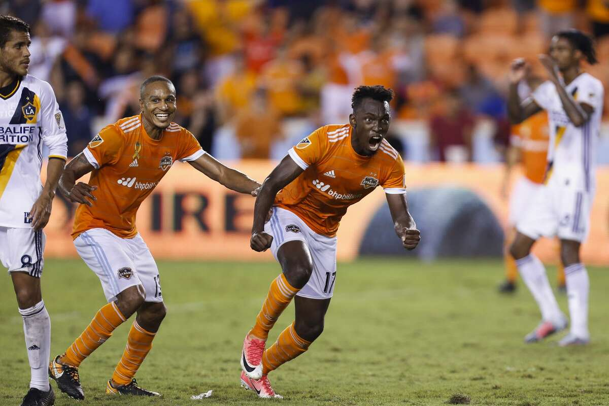 Houston Dynamo forward Alberth Elis (17), right, celebrates after heading in a corner kick for a goal as the Houston Dynamo tie the Los Angeles Galaxy 3-3 at BBVA Compass Stadium Wednesday, Sept. 27, 2017 in Houston. ( Michael Ciaglo / Houston Chronicle)