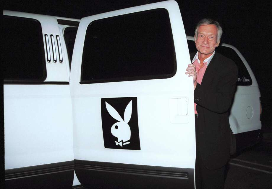 Playboy founder Hugh Hefner shows off his limo outside Barfly March 2, 2002 in West Hollywood, Calif. Photo: David Klein /Getty Images