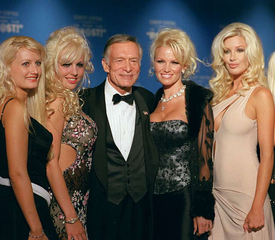 "Hugh Hefner poses with four of his girlfriends Sept. 29, 2001, before the start of a New York Friars Club Roast. The 77-year-old Playboy founder said he's interested in adding pop singer Britney Spears to his bevy of beautiful blond girlfriends. ""Britney would make a great girlfriend,"" Hefner told Us Weekly magazine for its Jan. 19 issue. Photo: JIM COOPER /AP / AP"