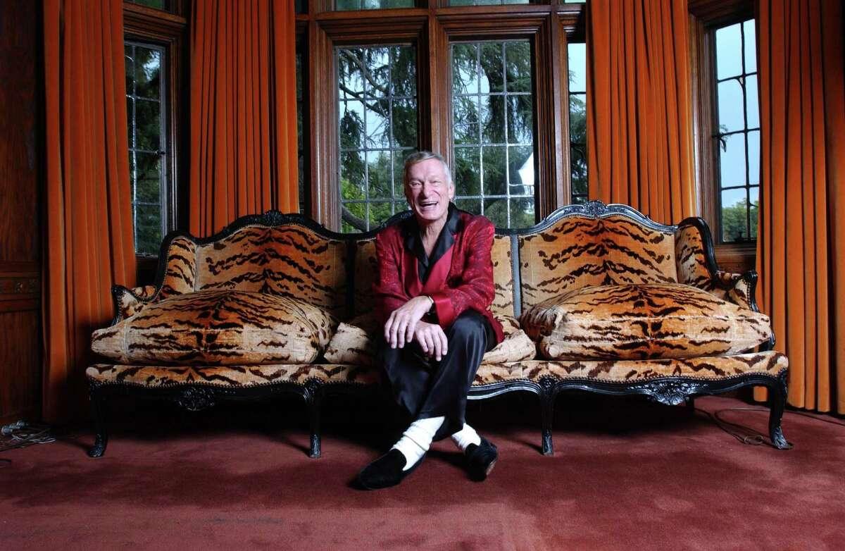 Hugh Hefner pose for photographs at the Playboy Mansion in Los Angeles, CA, November 12, 2003.